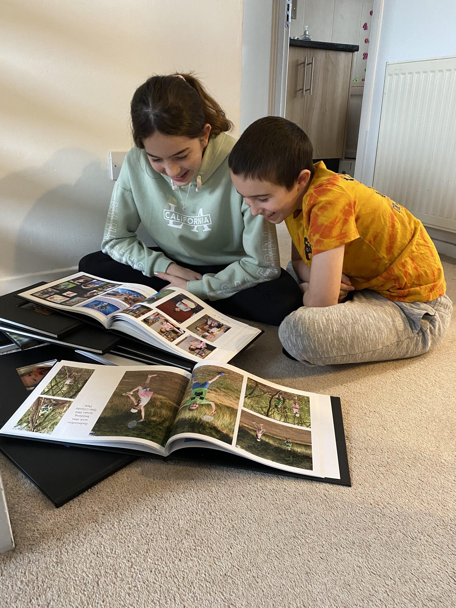 children enjoying photo books